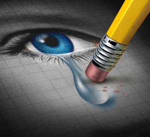 Depression Relief and conquering mental adversity with a pencil eraser removing a tear drop from a close up of a human face and eye as a concept of emotional support and therapy.